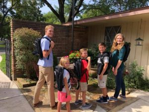 Hunter with his siblings, all wearing Day 1 Bags Backpacks. Image courtesy of the Day 1 Bags Facebook page.